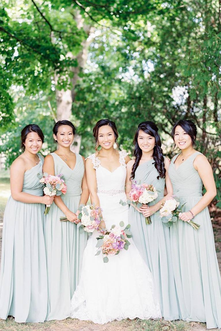 Real bridesmaids green dresses davids bridal bridesmaids posing with bride by trees ombrellifo Image collections