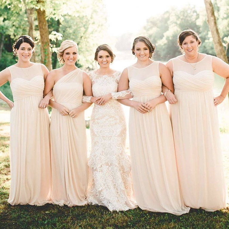 Bridesmaids closely linking arms