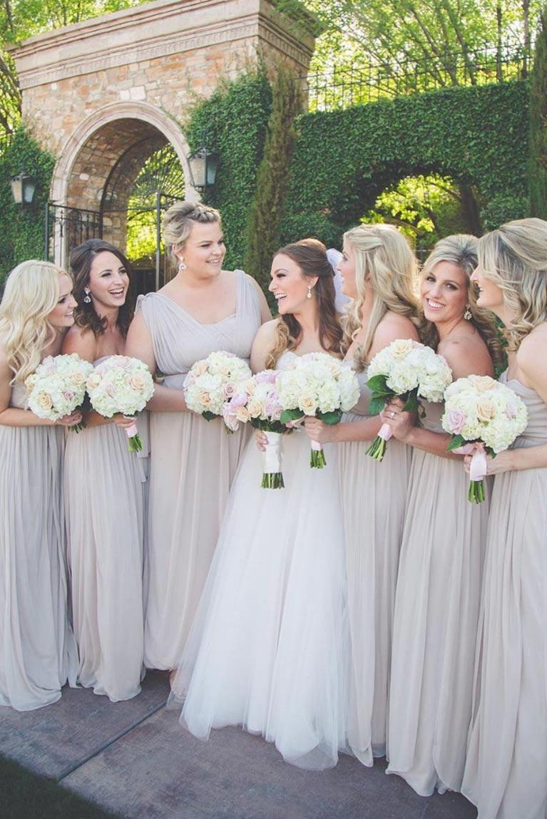 Real bridesmaids neutral dresses davids bridal bridesmaids gathering around bride near garden wall ombrellifo Images