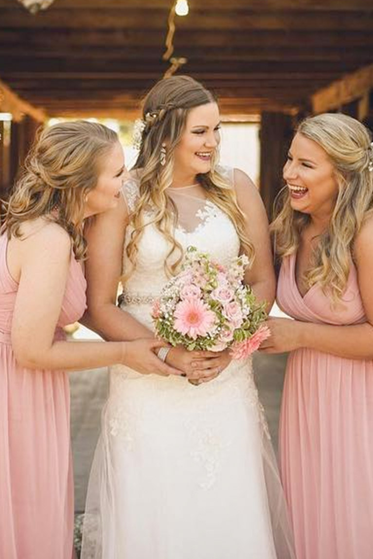 Bridesmaids Turned Towards Bride And Smiling
