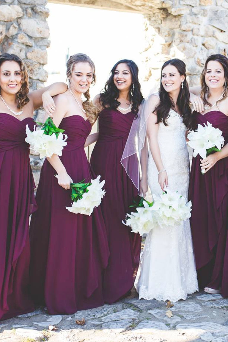 Real bridesmaids purple dresses davids bridal bridesmaids having fun posing by stone wall ombrellifo Image collections