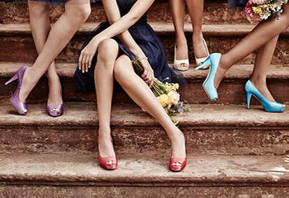 Girls sitting and standing on steps with Different Color Pumps On