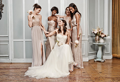 Bride Sitting Down Surrounded by 4 Bridesmaids in Metallic Dresses