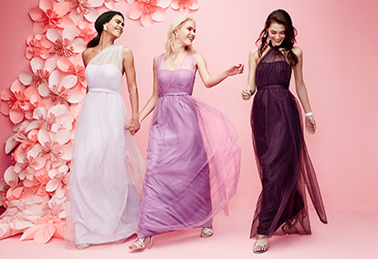Three Women Wearing All Different Color Purple Bridesmaid Dresses