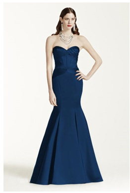 Bridesmaid Wearing A Long Strapless Satin Fit And Flare Dress