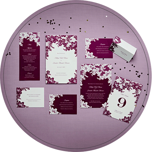 A collection of purple and white wedding invitations