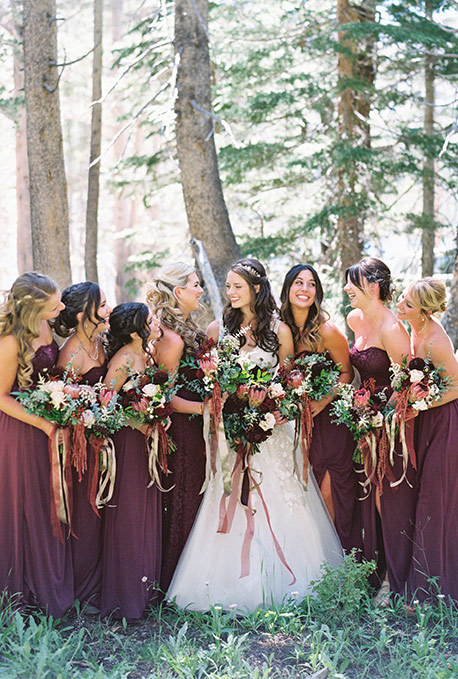 Fall autumn wedding colors ideas inspiration davids bridal bridal party standing in the forest junglespirit