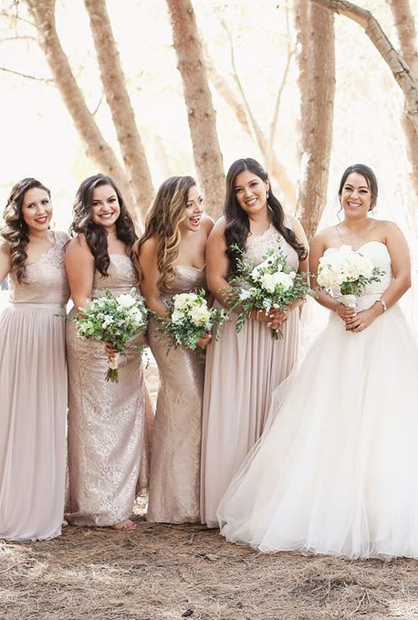 A bride and four bridesmaids in the forest