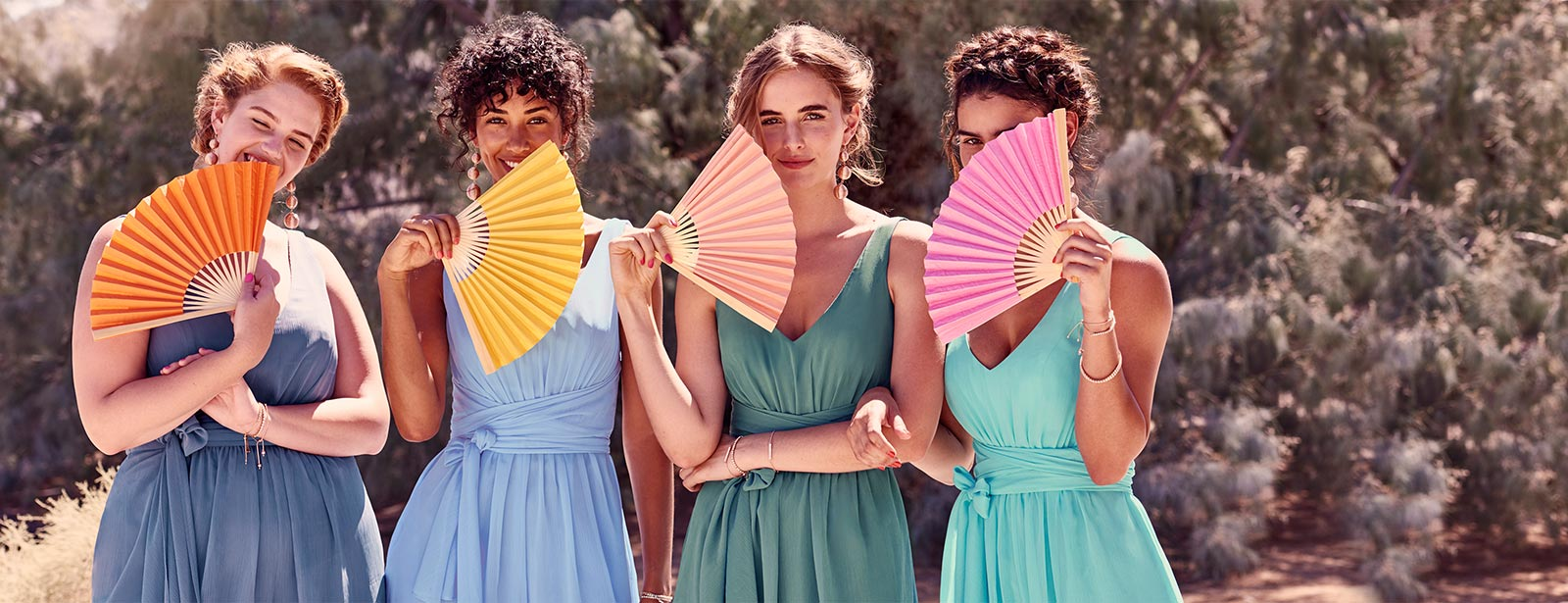 Spring wedding colors ideas inspiration davids bridal four bridesmaids holding colorful fans four bridesmaids holding colorful fans spring wedding junglespirit