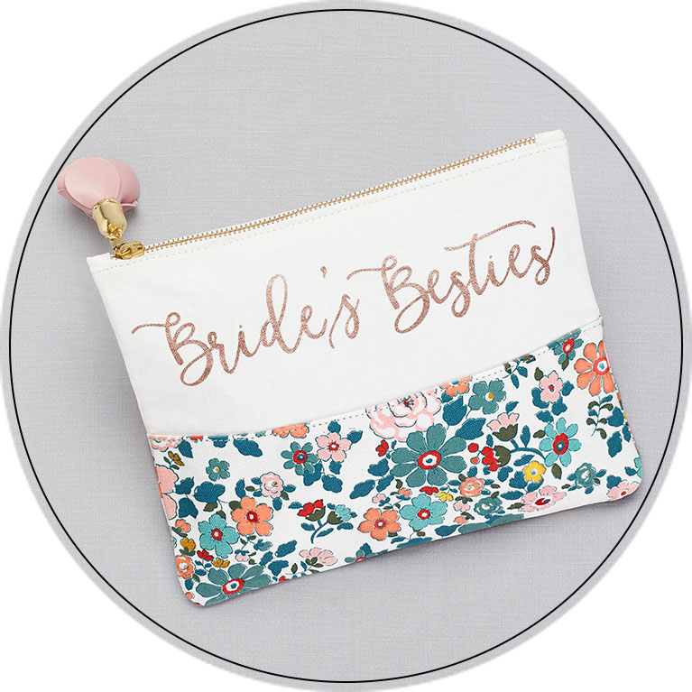 Floral cosmetic bag labeled Bride's Besties