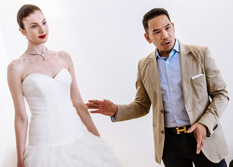 David's Bridal dress designer with model bride