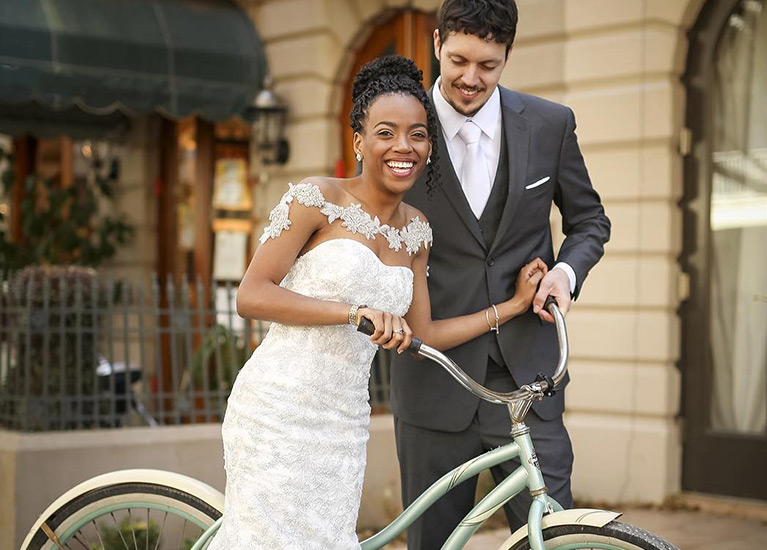 Real bride and groom with bicycle