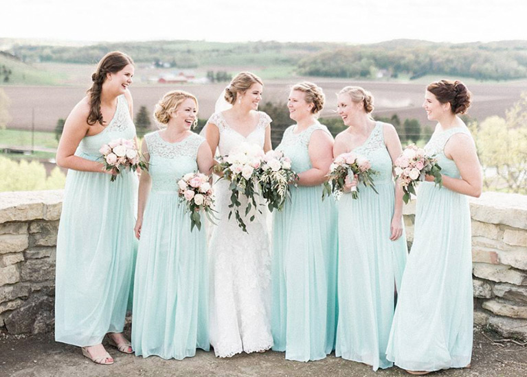 Real bride with bridesmaids in mint green mix and match dresses