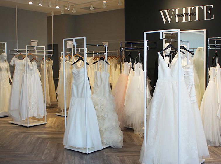 image of david s bridal store where vera s dresses hang