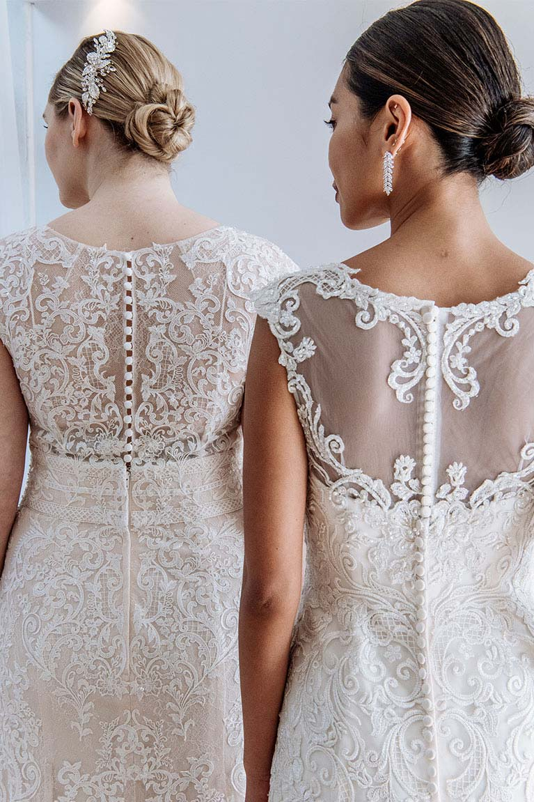 Lacy back detail of two brides