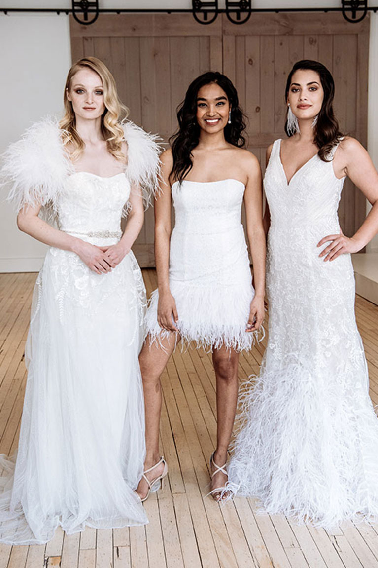Models posing in various feather wedding dresses