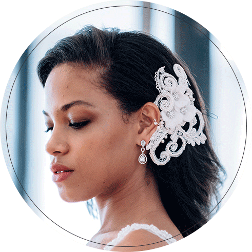 Close up of bride wearing a bold comb hair accessory