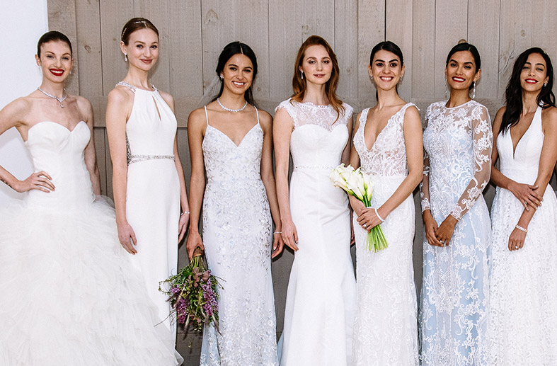 A group of brides in gowns featuring a variety of styles and sizes