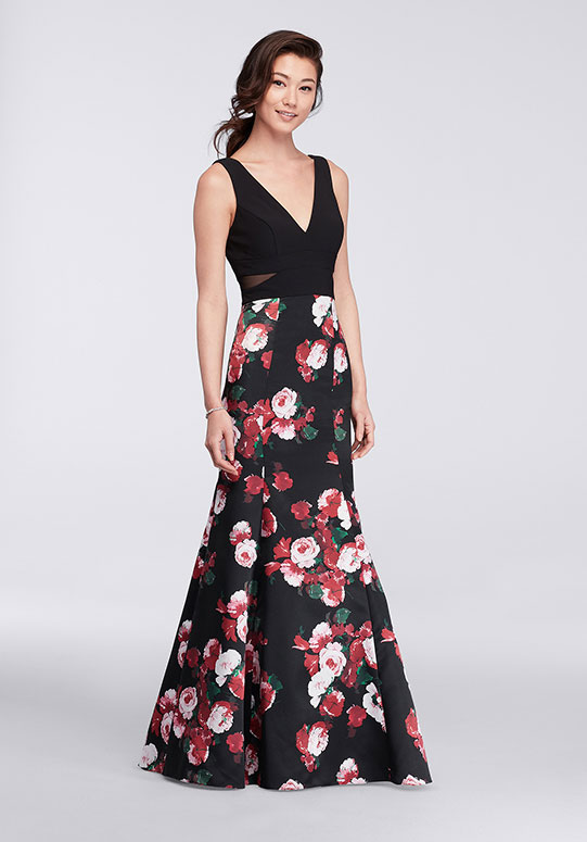 Woman in long V-neck mermaid dress with floral skirt