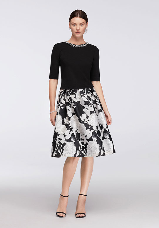 Black, ponte elbow-sleeve top with crystal bleeding with black and white skirt