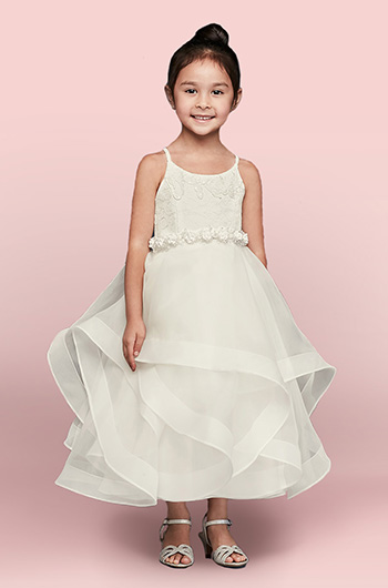 Flower girl wearing tiered ruffled dress