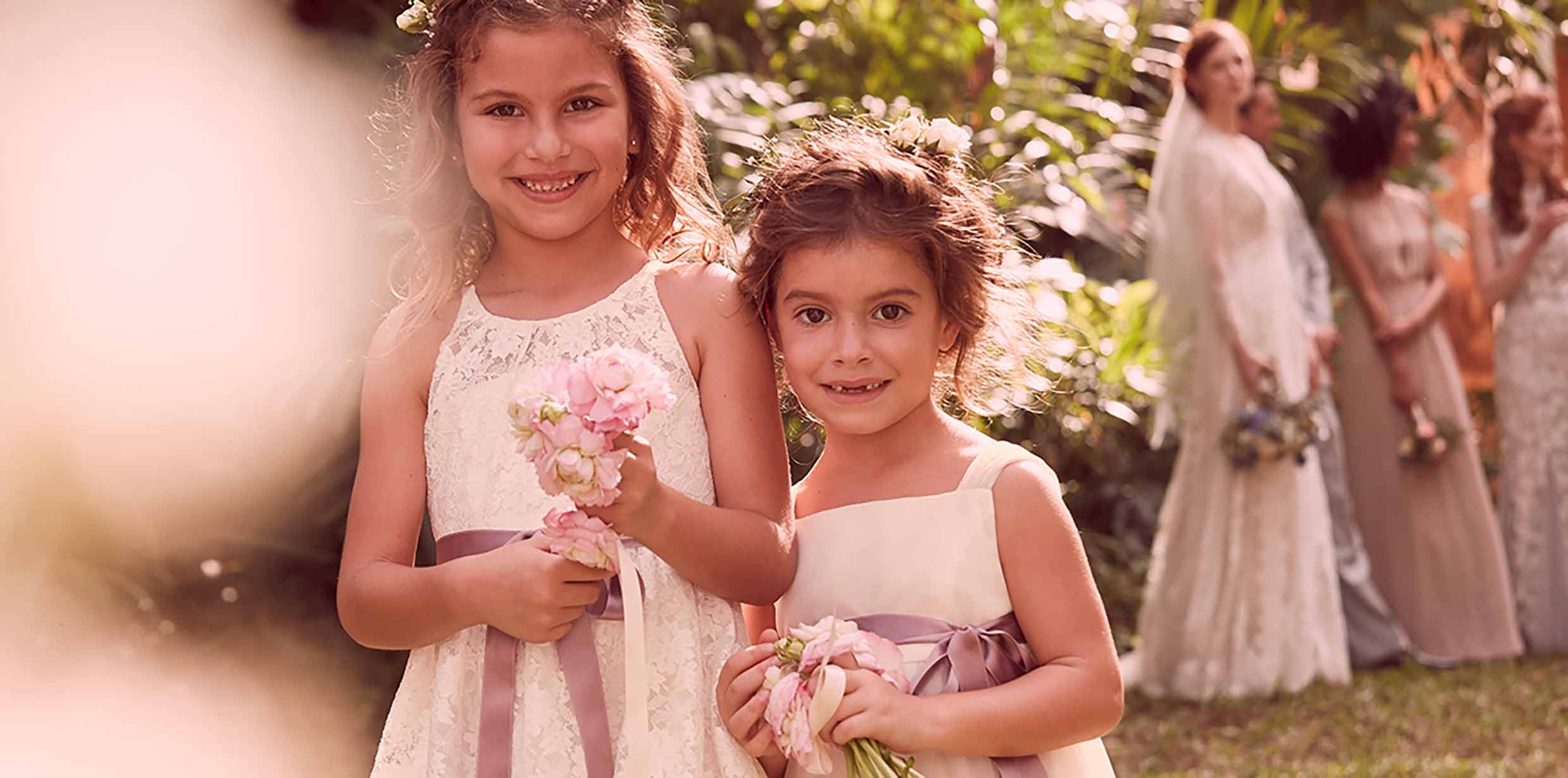 How to choose a flower girl dress davids bridal flower girls smiling down aisle ombrellifo Gallery