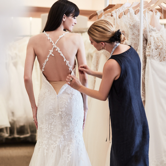 david's bridal alterations expert adjusting wedding gown.