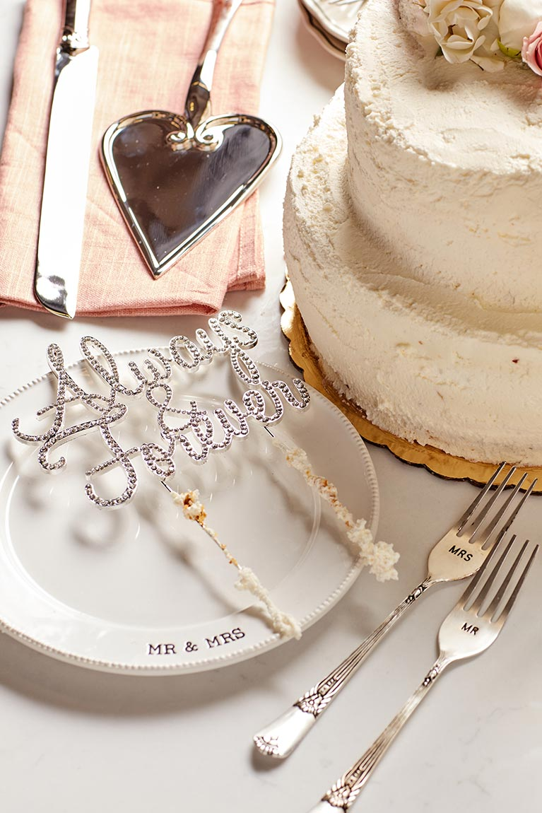 Wedding cake with topper and serving set.