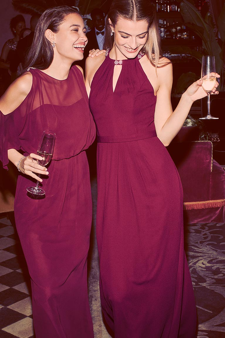 Bridesmaids wearing wine colored bridesmaid dresses.