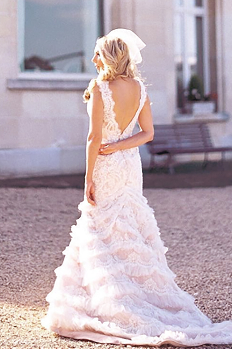 Bride wearing deep v-back Galina Signature wedding gown