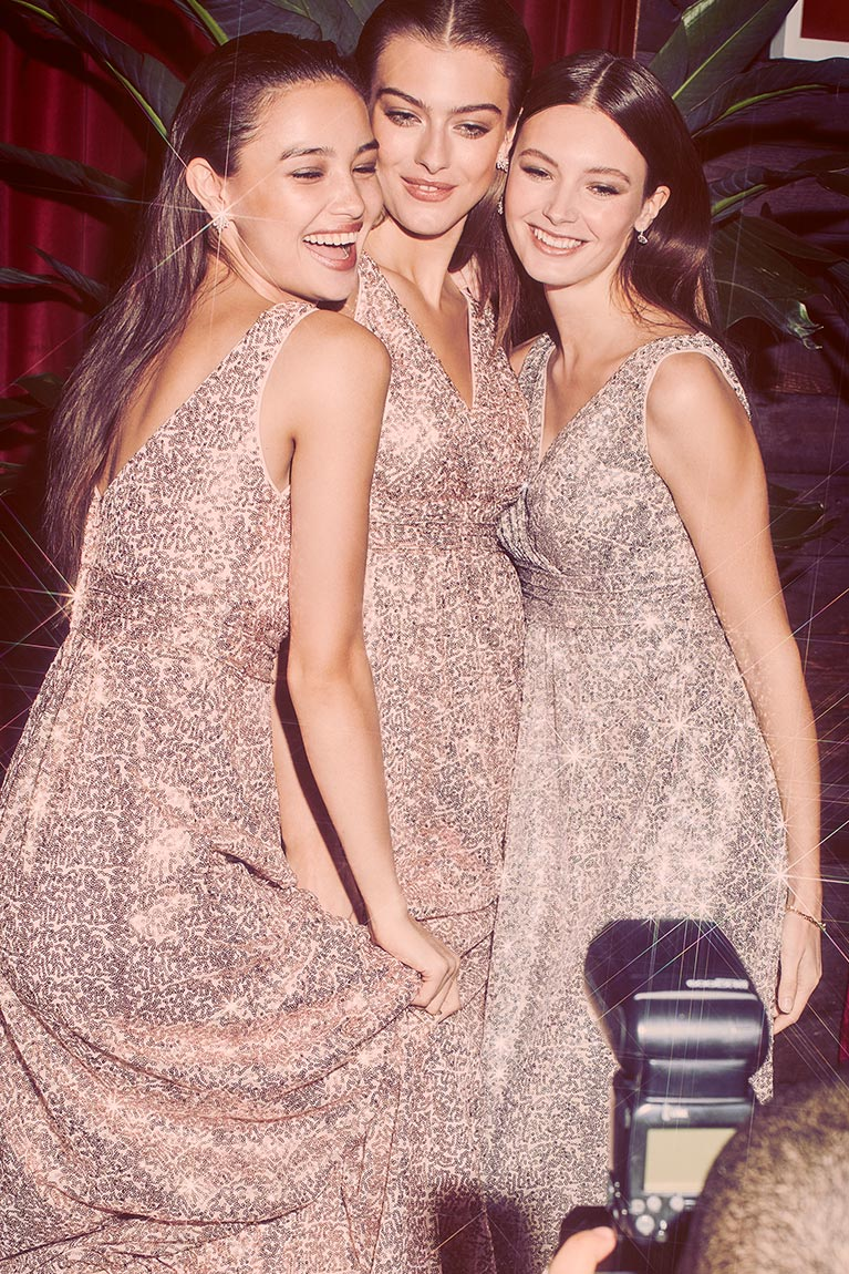 Bridesmaids in sequined, sparkly matching bridesmaid dresses.