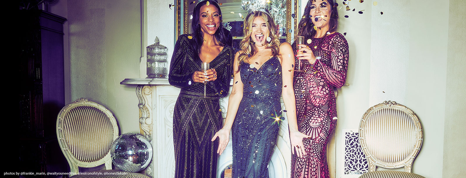 Three party goers wearing long sparkly dresses throwing confetti