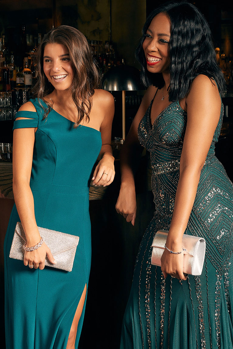 Two girls wearing green holiday dresses.