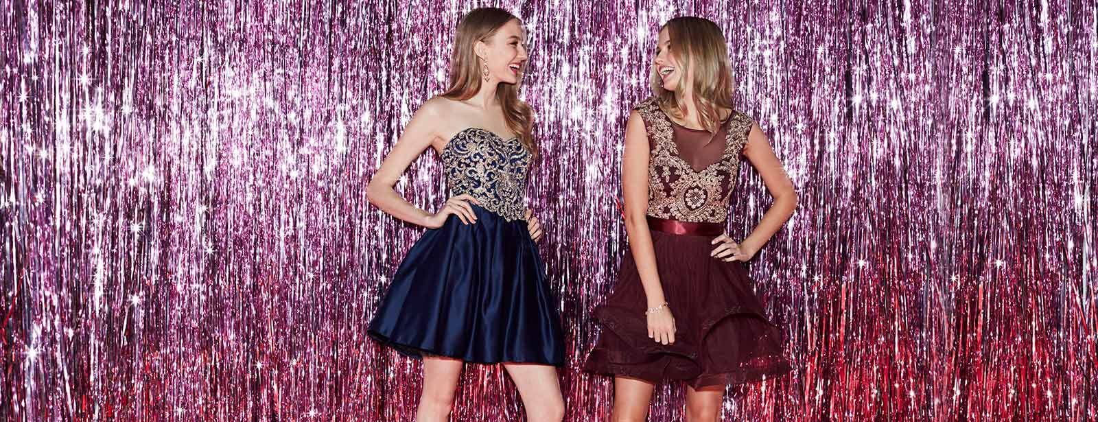 Girls at their homecoming dance laughing and having fun.