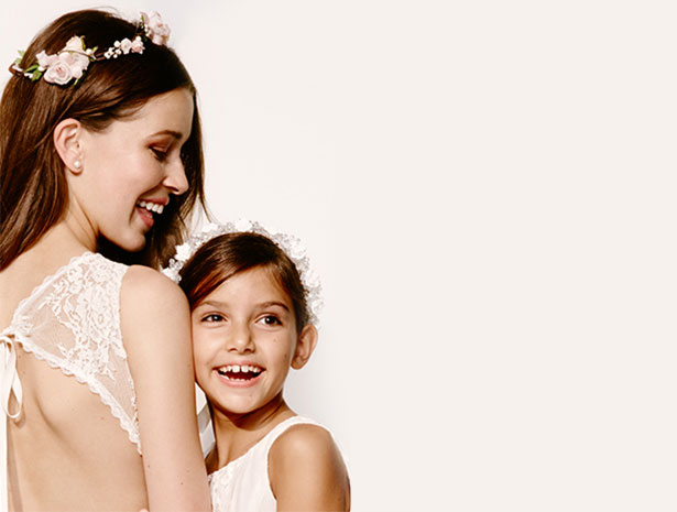 Bride and Flower Girl Laugh while Wearing Flower Crowns