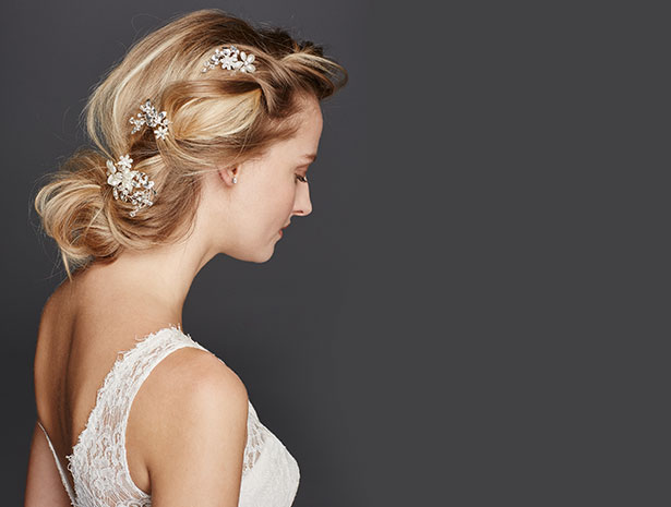 Bride Wearing Chrystalled Flower Pins in her Hair