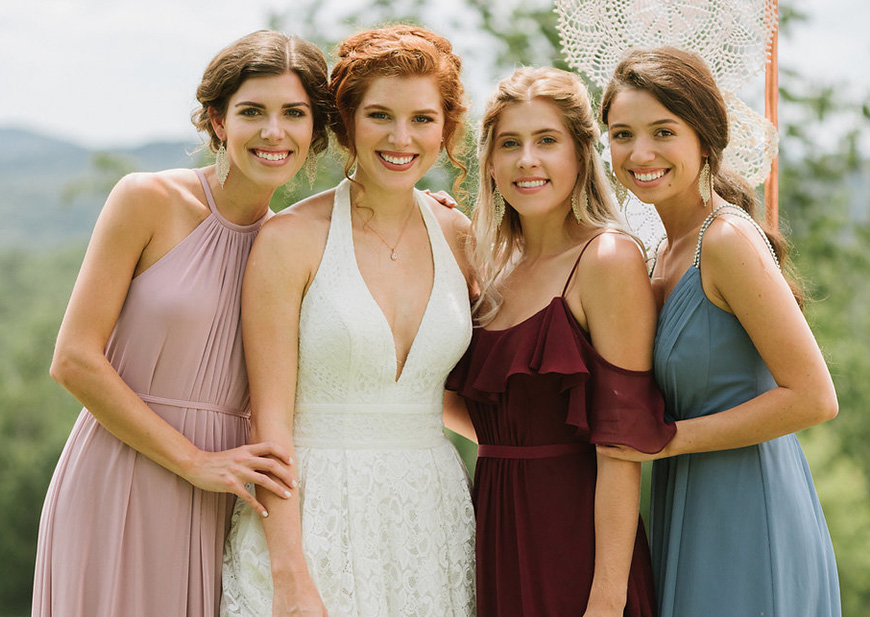 Bride with bridesmaids in unique color palette: pink, wine and blue