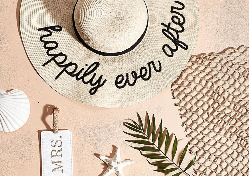 Happily Ever After hat and Mrs. Luggage tag in beach scene