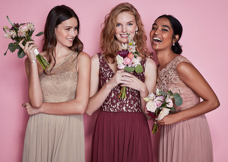 Bridesmaids wearing lace and chiffon dresses in fall hues