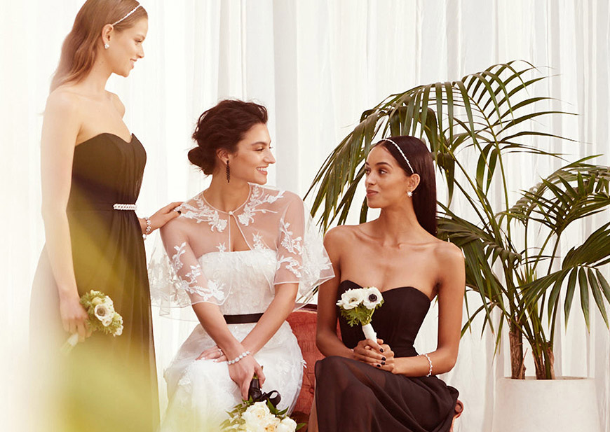 Bride talking to the bridesmaids with black accents on wedding day