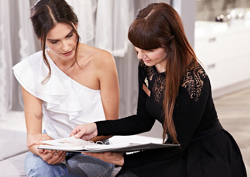 Bridal stylist helping bride-to-be at a store appointment