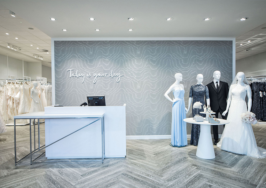 Welcome desk and mannequin display at David's Bridal store