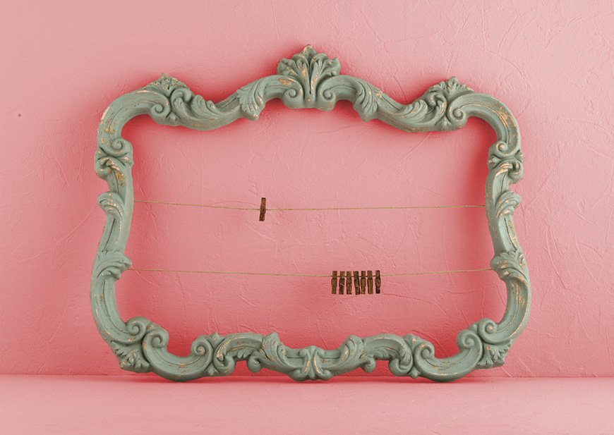 Ornate vintage frame with close pin lines to hold place cards or photos
