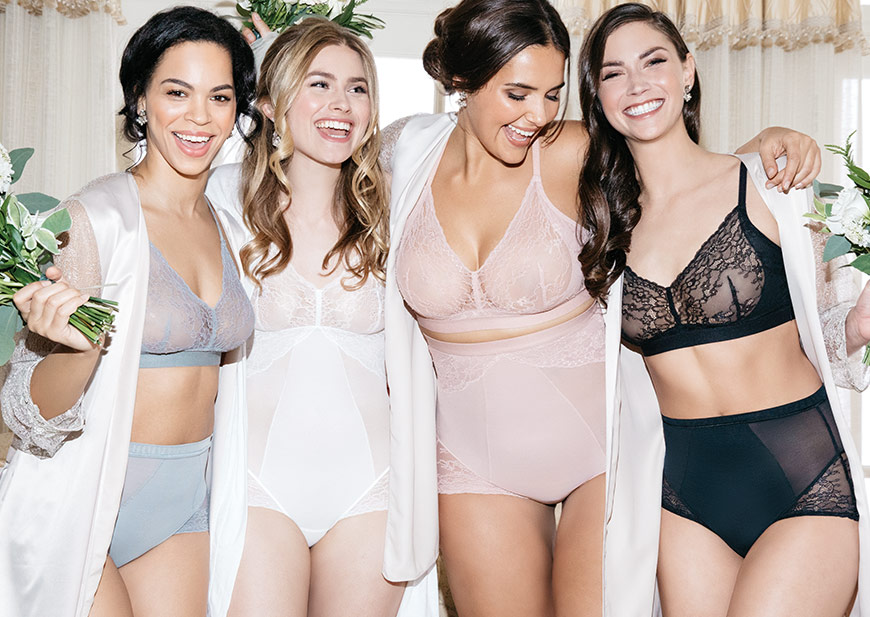 Group shot of bride and bridal party in Spanx shapewear and robes