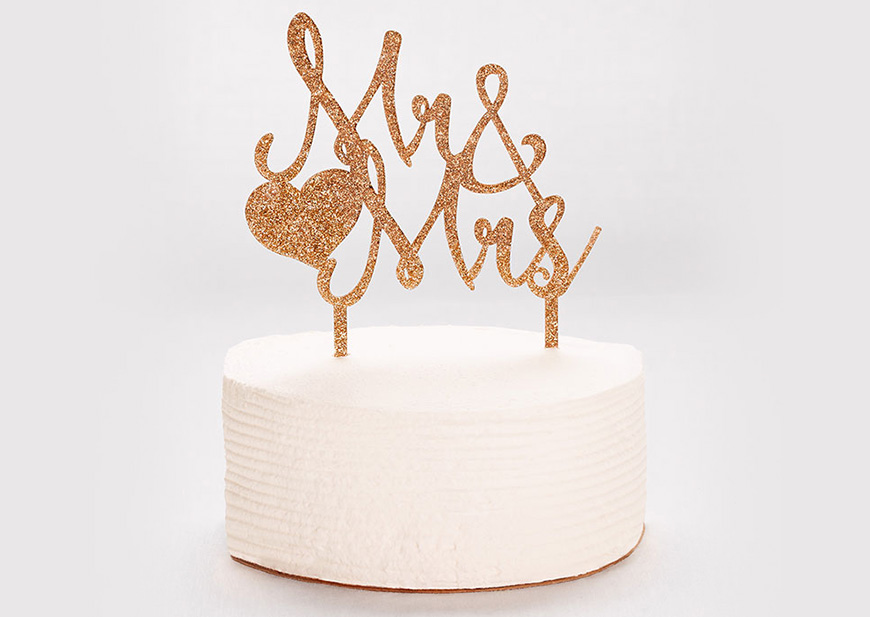 White cake with 'Mr. & Mrs' cake topper