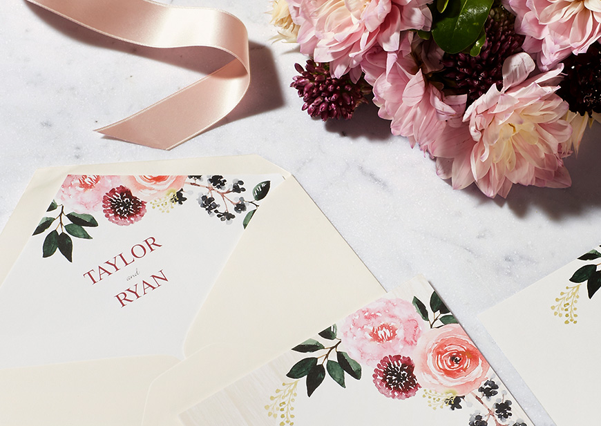 Wedding invitation with floral illustration and cream envelope, flower in back