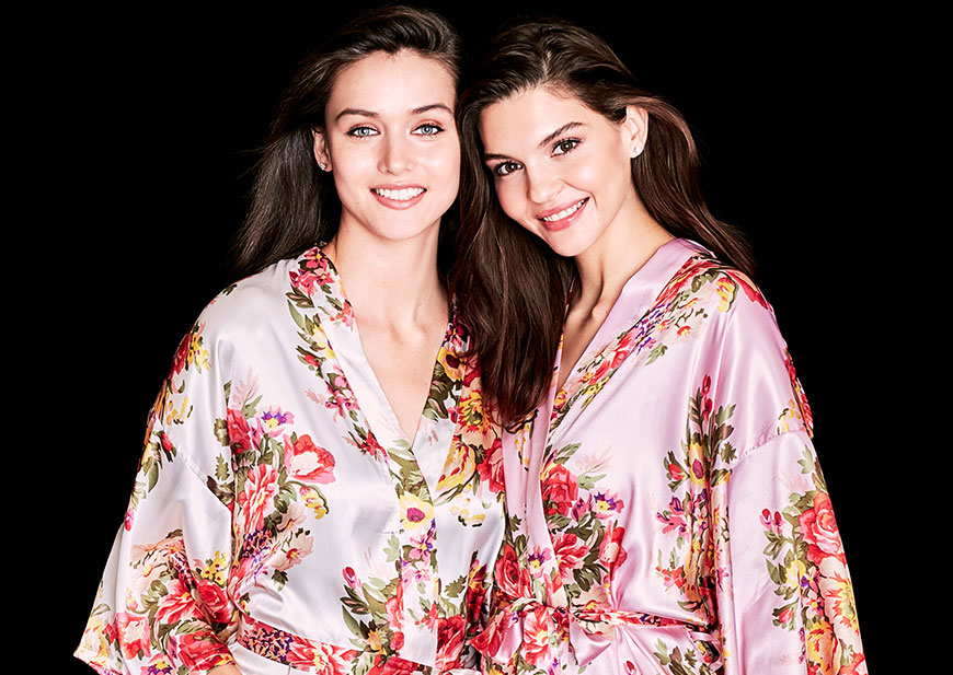 Bridesmaids wearing pink floral bridesmaid robes