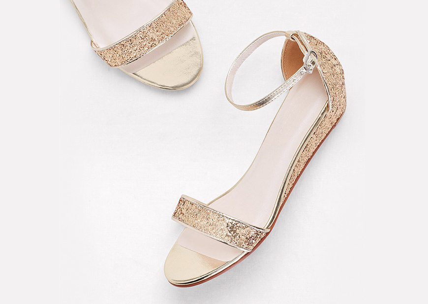 Close-up of gold prom sandals