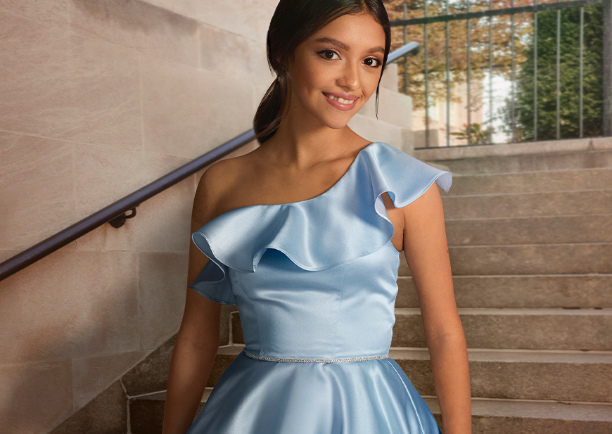 High School girl wearing short strapless navy and gold dress