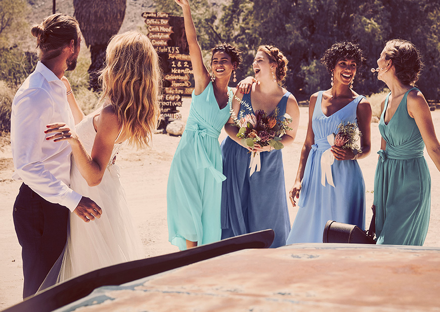 Bridesmaids in navy dresses beautifully crafted, perfectly priced